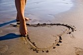 3650722-girl-drawing-an-heart-in-the-sand